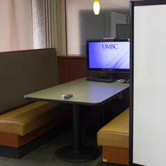 Booth, computer, and whiteboard in the Retriever Learning Center RLC