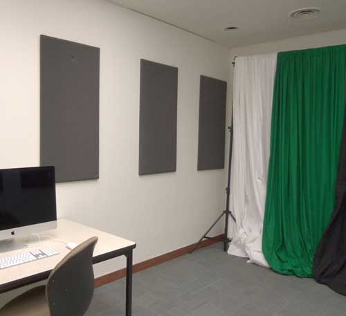 Audio/Video Recording Room containing backdrop stand, sound baffling, and a computer workstation