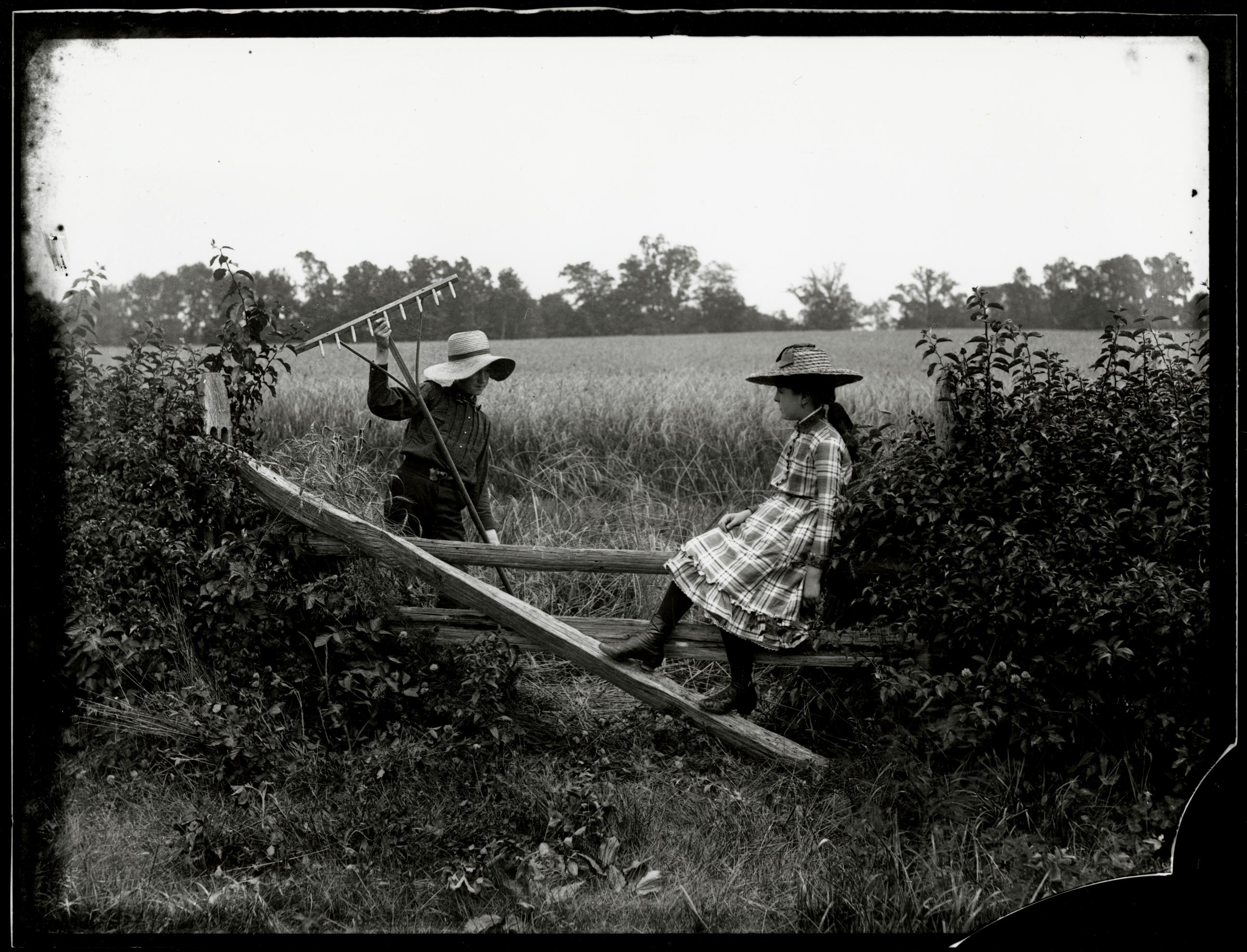 An Idle Moment, On Fence Near Salem, circa 1898 by John G. Bullock